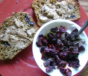 Banana Goodness Bread Toast With White Chocolate Cherry Almond Butter, Vanilla Oikos With Newman's Own Organic Super Dark Chocolate And Dried Cherries