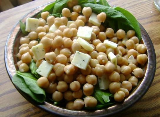 Chickpea And Raw Cheese Salad Over Dressed Spinach