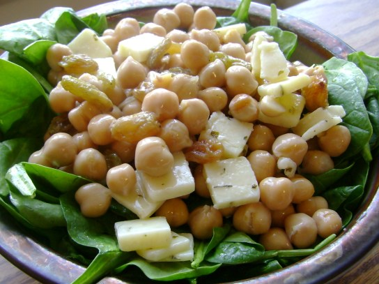 Chickpea Salad With Raw Garlic Cheddar, Maple Golden Raisins, And Hemp Oil Spinach