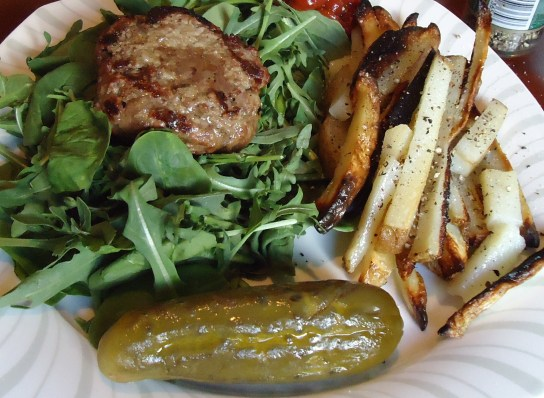 Grass-Fed Burger Over Bitter Greens, Grilled Potato Fries, Pickle