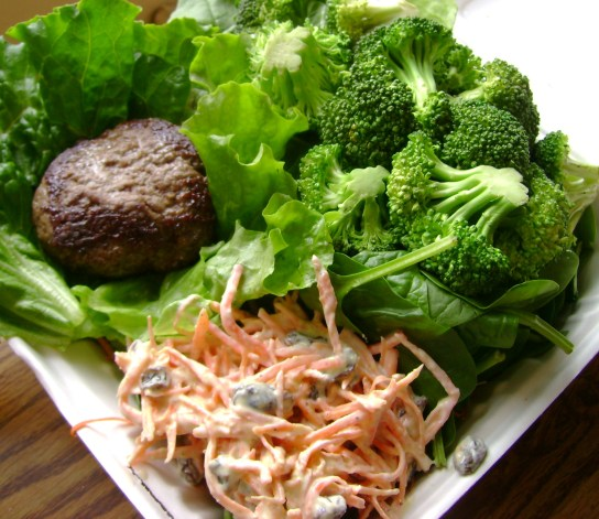Grass-Fed Burger, Steamed Broccoli Over Spinach, Tangy Mustard Carrot Raisin Salad